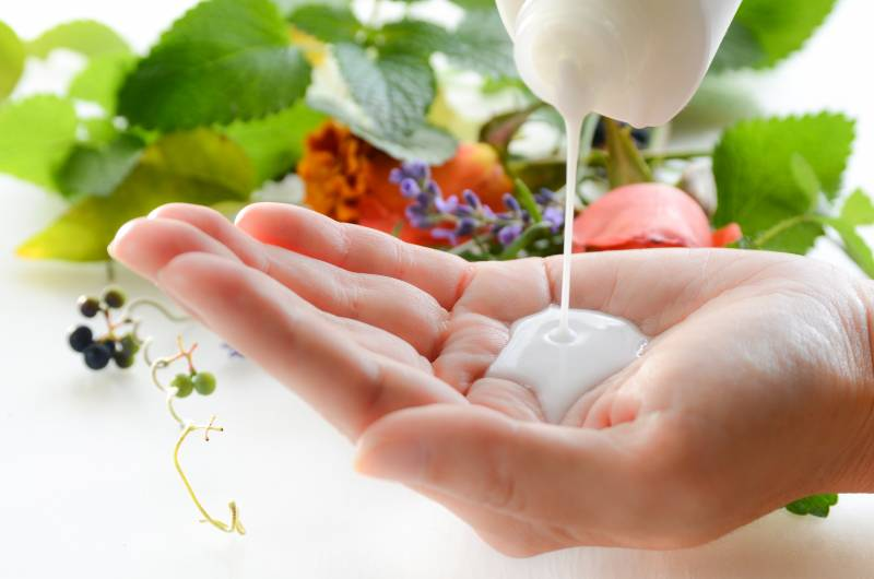 milky lotion for beauty treatment with fresh herbs