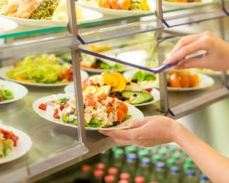 Fresh salad buffet self-service food display human hand take plate