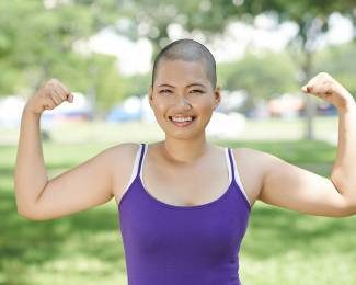 Portrait of sporty Asian woman showing her biceps