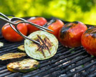 Vegetarian barbecue with tomato, eggplant, grilled on grill