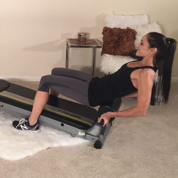 Massage tight back muscles with the Total Gym Roller