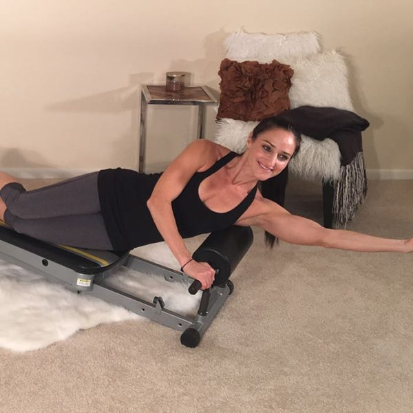 Massage tight lat muscles with the Total Gym Roller